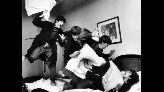 The Beatles have apillow fight at ahotel in Paris in 1964. Harry Benson, the photographer who traveled with the band, shared these photos from his personal collection.
