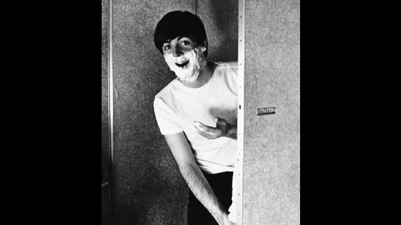Paul McCartney shaves while on the road in 1964.