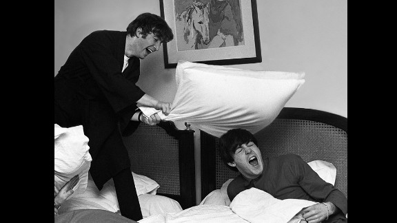 John Lennon hits McCartney with a pillow in 1964.