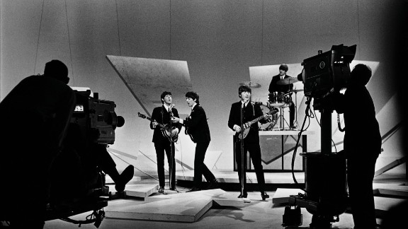 """The Beatles perform on """"The Ed Sullivan Show"""" in 1964."""