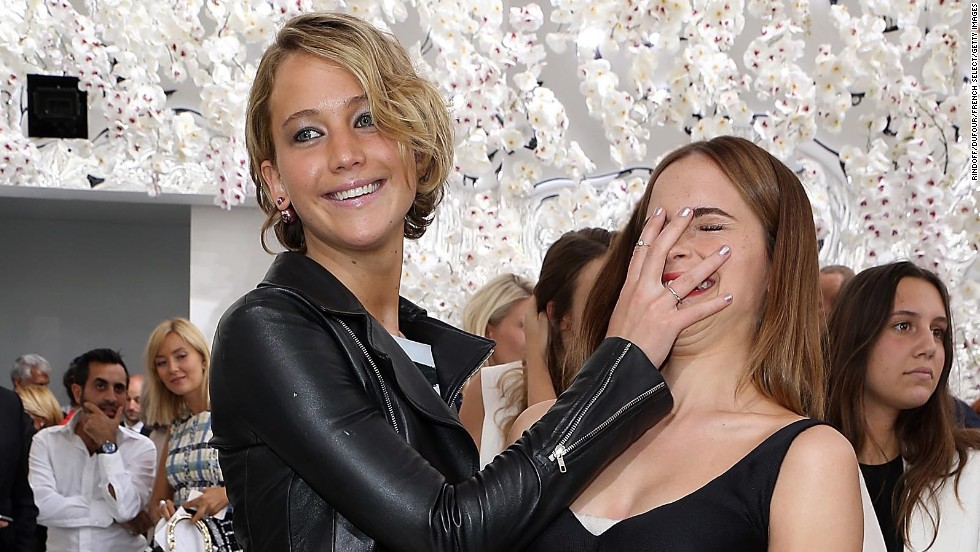 Jennifer Lawrence playfully covers the face of fellow actress Emma Watson as they attend the Christian Dior show during Paris Fashion Week on Monday, July 7.