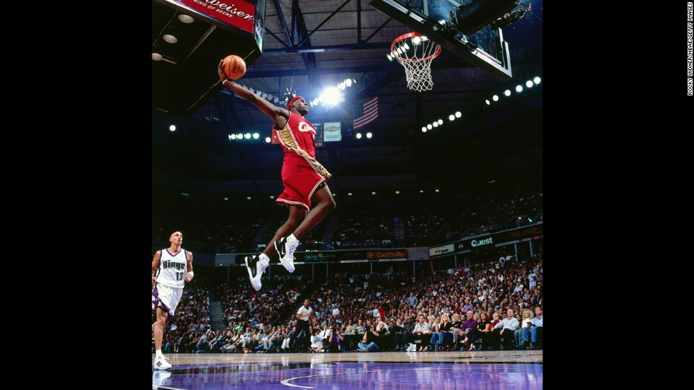 James goes for a dunk during an October 2003 game in Sacramento, California. In his first year in the NBA, he won the league's Rookie of the Year Award.