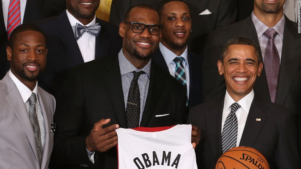 James presents President Obama with a jersey while the Heat were being honored at the White House in January 2013.