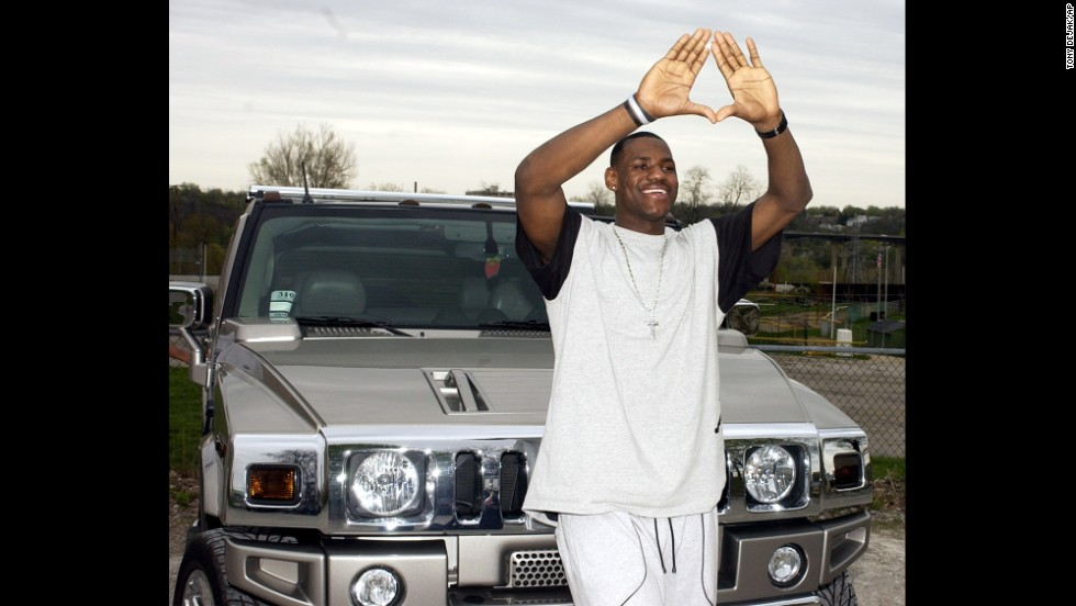 James poses in front of a Hummer after a news conference at St. Vincent-St. Mary High School in April 2003.