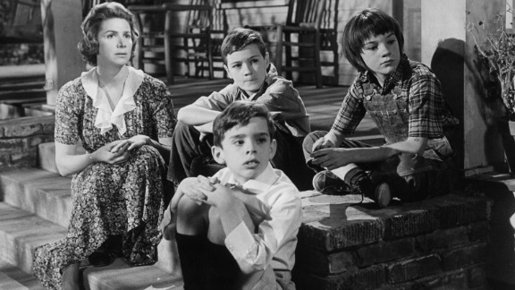 """Rosemary Murphy, left, sits with Mary Badham, top right, and other children in a scene from the film """"To Kill A Mockingbird."""""""