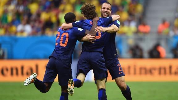 Daley Blind of the Netherlands, center, celebrates scoring his team's second goal with Georginio Wijnaldum, left, and Ron Vlaar.