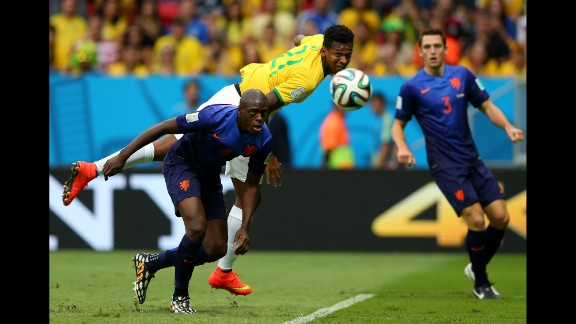 Jo of Brazil and Bruno Martins Indi of the Netherlands compete for the ball.