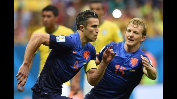 Netherlands forward and captain Robin van Persie, left, celebrates with Netherlands midfielder Dirk Kuyt after scoring a goal.