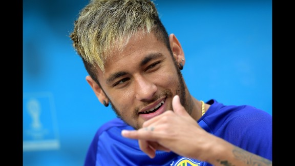 Injured Neymar of Brazil looks on during the warmup prior to the game.