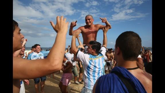Argentina fans gather on Copacabana Beach ahead of the match in Rio de Janeiro, Brazil.