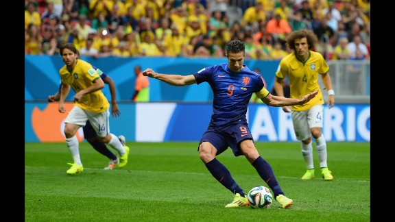 Robin van Persie of the Netherlands shoots and scores the first goal of the third-place match.