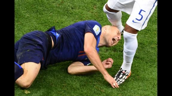 Netherlands forward Arjen Robben hits the ground.