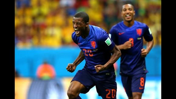 Georginio Wijnaldum of the Netherlands celebrates scoring his team's third goal in the World Cup third-place match in Brasilia. Netherlands defeated Brazil 3-0.
