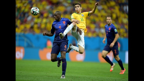 Oscar of Brazil and Bruno Martins Indi of the Netherlands compete for the ball.