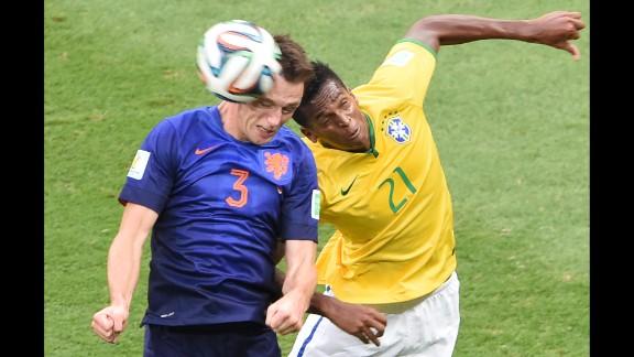 Netherlands defender Stefan de Vrij, left, and Brazil forward Jo vie for the ball.