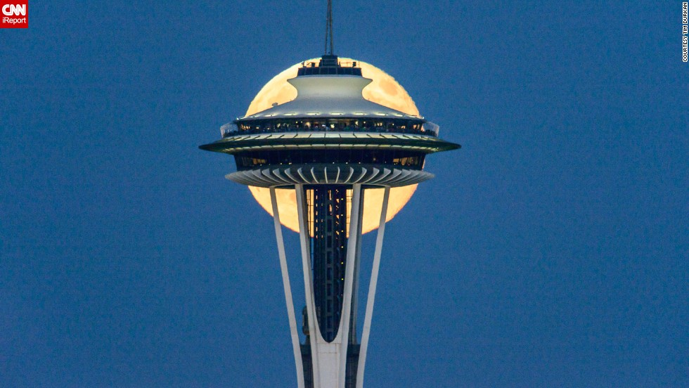 "It took <a href=""http://ireport.cnn.com/docs/DOC-1152205"">Tim Durkan</a> a few stretches of lonely nights in July to get the perfect shot of the supermoon behind the Space Needle in Seattle."