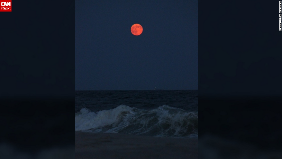 "As the supermoon rose over the Long Island coast, <a href=""http://ireport.cnn.com/docs/DOC-1152204"">Elias Aliprandis </a>said he was inspired to take a photo because of its amazing beauty and bright orange hue."