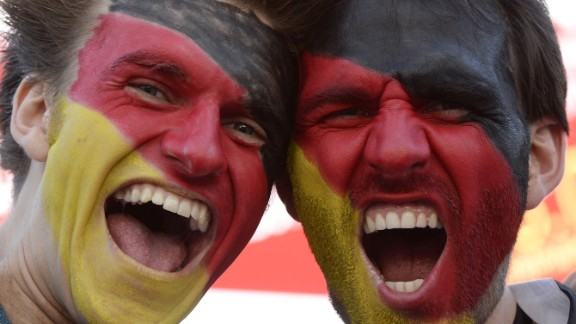 German fans pose ahead of the game at the Olympic stadium in Munich.