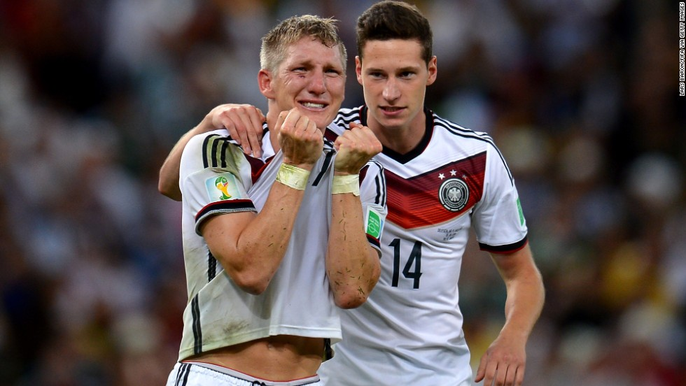Schweinsteiger, left, and Julian Draxler react after the match.