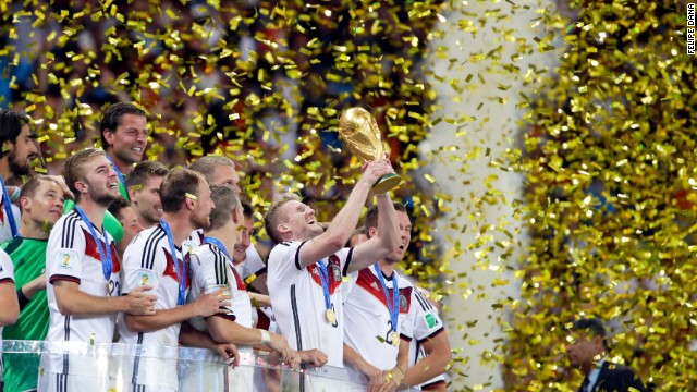 Germany's Andre Schuerrle holds up the World Cup trophy as the team celebrates their 1-0 victor over Argentina after the World Cup final soccer match between Germany and Argentina at the Maracana Stadium in Rio de Janeiro, Brazil, Sunday, July 13, 2014. (AP Photo/Felipe Dana)