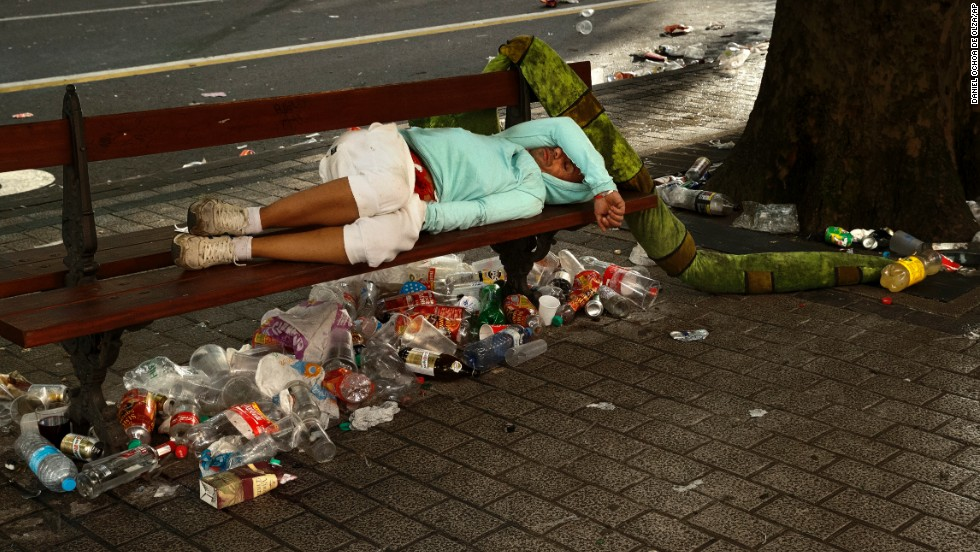 A reveler sleeps on a public bench on July 13.