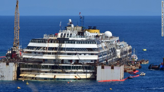 A general view shows the wrecked Costa Concordia cruise ship that lays off the Giglio island on July 13, 2014. Italian authorities gave today their final go-ahead for operations to lift and tow away the Costa Concordia cruise ship from its watery grave to begin on July 14, 2014. Over two and a half years after it crashed off the island of Giglio in a nighttime disaster which left 32 people dead, the plan is to raise and tow away the 114,500-tonne vessel in an unprecedented and delicate operation for its final journey to the shipyard where it was built in the port of Genoa.  AFP PHOTO / GIUSEPPE CACACE        (Photo credit should read GIUSEPPE CACACE/AFP/Getty Images)
