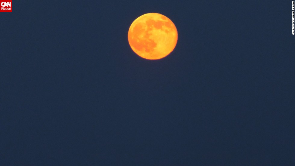 "Over the years, Katherine Murray has taken some nice full moon photos from the <a href=""http://ireport.cnn.com/docs/DOC-1152270"">Outer Banks</a> of North Carolina, but capturing an orange moon had eluded her until this weekend. ""I was thrilled to be able to get the actual color as it came over the dunes,"" she said."