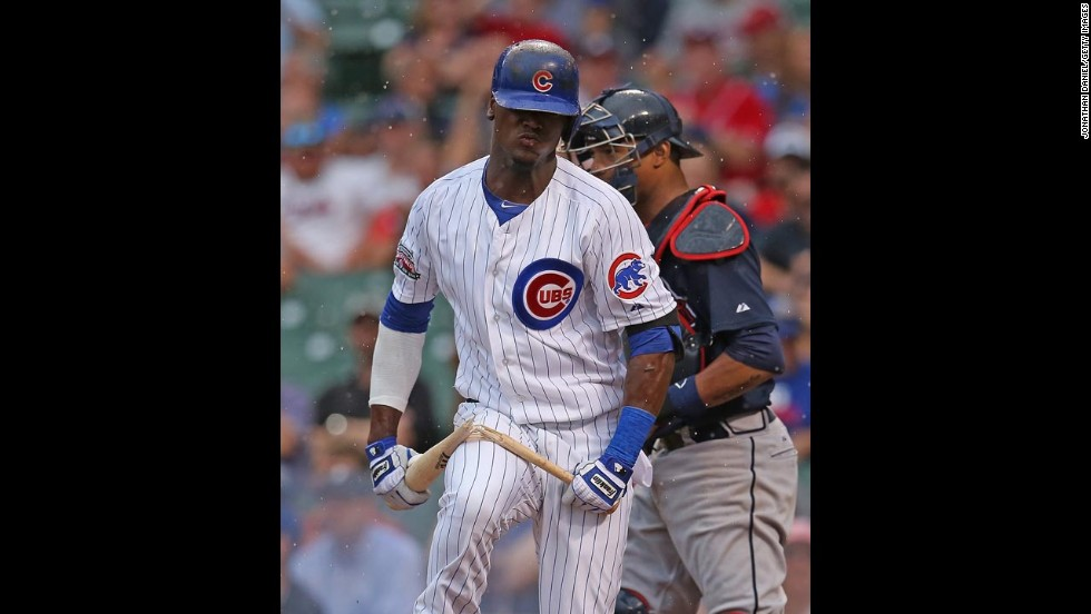 Junior Lake of the Chicago Cubs breaks his bat over his leg after he struck out with the bases loaded Friday, July 11, in a home game against the Atlanta Braves.