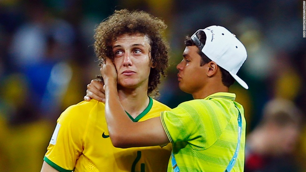Brazilian defender David Luiz, left, is consoled by teammate Thiago Silva after Brazil was thrashed 7-1 by Germany in the World Cup semifinals on Tuesday, July 8.