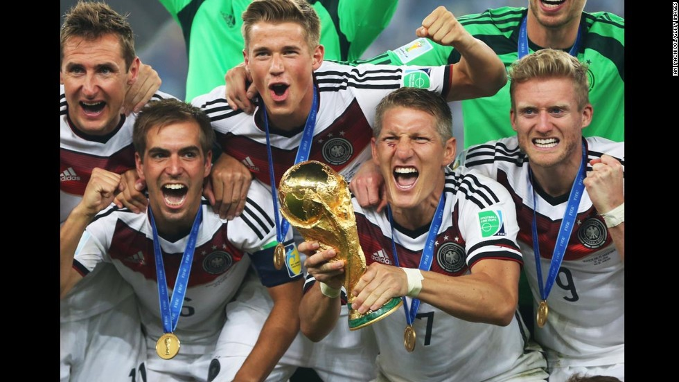 "German players celebrate with the World Cup trophy after they defeated Argentina 1-0 in the tournament's <a href=""http://www.cnn.com/2014/07/13/worldsport/gallery/world-cup-final-germany-argentina-2014/index.html"">final match</a> Sunday, July 13, in Rio de Janeiro. Mario Gotze's goal in extra time was the difference."