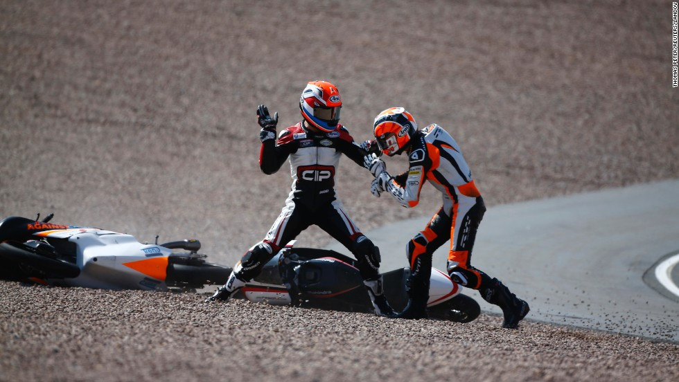 Moto3 rider Bryan Schouten, left, fights with Scott Deroue after they crashed during the German Grand Prix on Sunday, July 13.