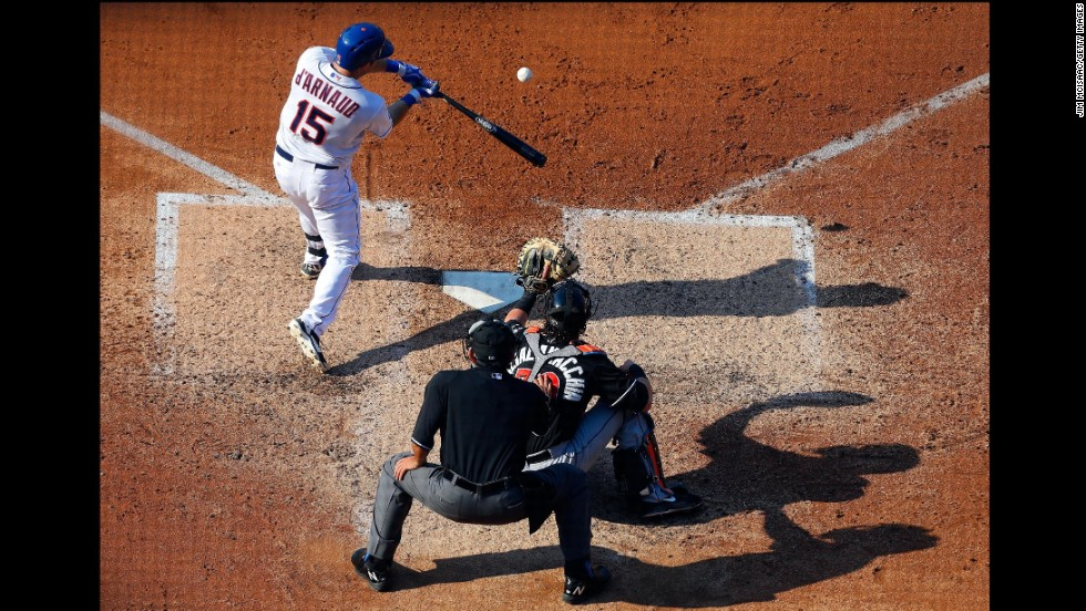 Travis d'Arnaud of the New York Mets connects on a base hit Saturday, July 12, in a home game against the Miami Marlins.