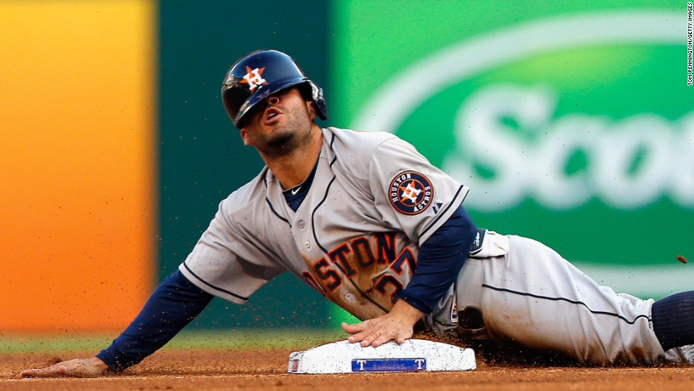 Jose Altuve of the Houston Astros slides into second base during a game against the Texas Rangers on Tuesday, July 8. Altuve has 41 stolen bases at the All-Star break.