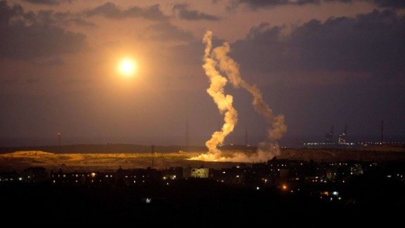 A photo taken on July 15, 2014 from the southern Israeli Gaza border shows Israeli army flares falling into the Palestinian enclave. Israel's security cabinet was to meet early on July 15 to discuss Egyptian proposals for a truce in Gaza, a senior official said, as an aerial campaign against Hamas entered its eighth day. AFP PHOTO/MENAHEM KAHANA (Photo credit should read MENAHEM KAHANA/AFP/Getty Images)