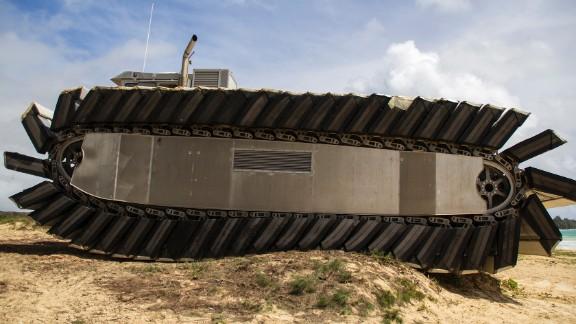 The UHAC rolls over a sand dune near the beach at Marine Corps Training Area Bellows on Oahu, Hawaii.