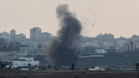 A picture taken from the southern Israeli city of Sderot shows smoke billowing from the Gaza Strip following an Israeli air strike on July 15, 2014. Prime Minister Benjamin Netanyahu pledged today to ramp up Israel's military campaign against Gaza, after an Egyptian truce plan failed to end eight days of cross-border fire.