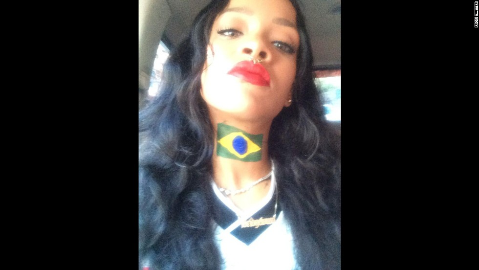 "Pop star Rihanna shows off a Brazilian flag painted on her neck Sunday, July 13. She was in Brazil for the World Cup final between Germany and Argentina. ""We in #BRA bout to watch #GER and #ARG live and direct!!!!"" <a href=""https://twitter.com/rihanna/status/488367164018393088"" target=""_blank"">she said on Twitter.</a>"