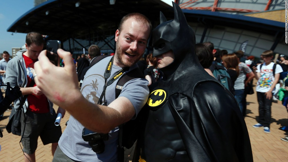 A man gets a selfie with Batman at the London Film and Comic Con on Saturday, July 12.