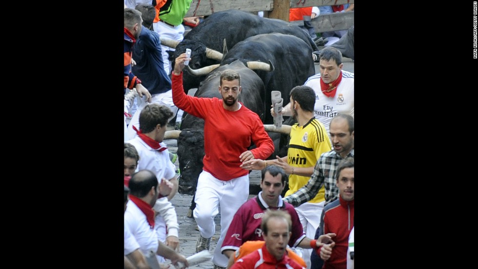 "A man takes a selfie Friday, July 11, as he participates in the annual <a href=""http://www.cnn.com/2014/07/07/world/gallery/running-of-the-bulls/index.html"">running of the bulls</a> in Pamplona, Spain. The bull run, a 400-year tradition, is part of the San Fermin festival. <a href=""http://www.cnn.com/2014/07/09/world/gallery/look-at-me-0709/index.html"">See 19 selfies from last week</a>"