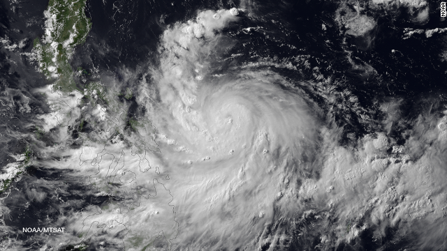 Satellite image shows Rapu-Rapu Island in the Philippines in the center of the eye of Typhoon Rammasun on Tuesday, July 15, 2014. Typhoon Rammasun is well-structured with a 20 nautical mile diameter eye after rapid intensification overnight. As the storm tracks toward Manila weakening its forecast as it interacts with land bringing with it possibilities for heavy flooding and mudslides. Rammasun is expected to reintensify as it enters the South China Sea due to a favorable upper-level environment and warm sea surface temperatures. Landfall on northern Hainan Island is expected in three days, and the storm is expected to maintain Typhoon strength for its final landfall in northern Vietnam near Hanoi.