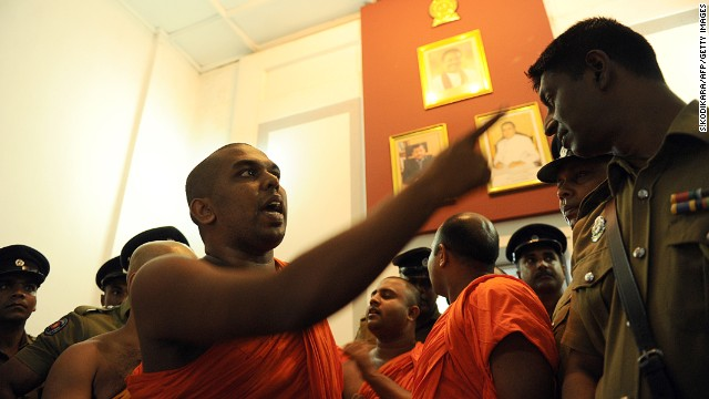 A monk from the BBS remonstrates with a police officer at the Trade Ministry in Colombo in April.