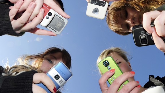 Teenagers use their mobile phones after school time in Vaasa, Finland, on March 30, 2010. AFP PHOTO / OLIVIER MORIN (Photo credit should read OLIVIER MORIN/AFP/Getty Images)