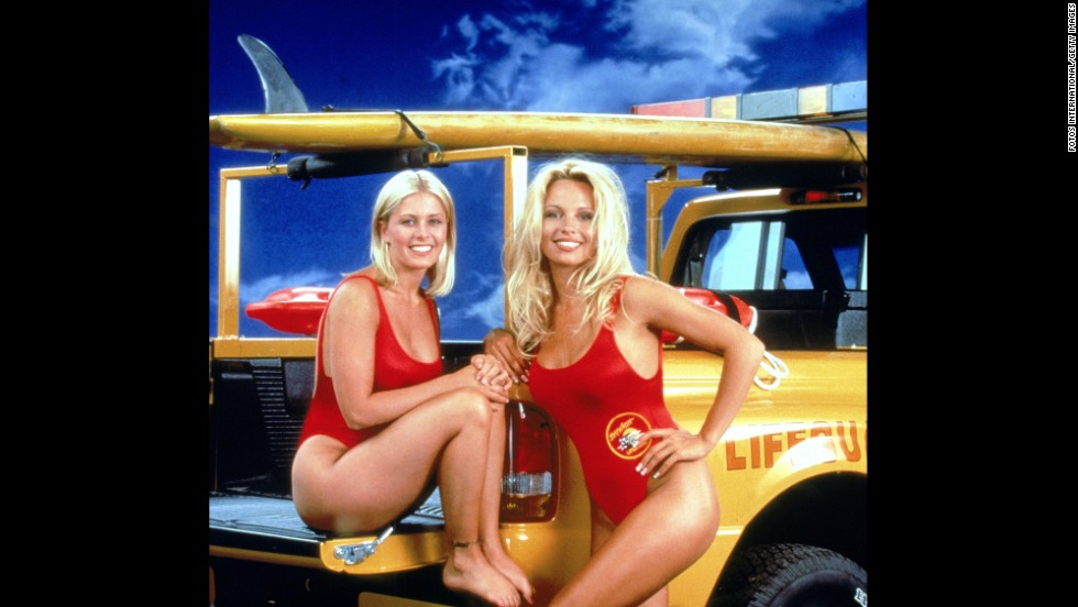 "Nicole Eggert, left, Pamela Anderson and their low-cut red swimsuits made waves in the 1990s on the television show ""Baywatch."""