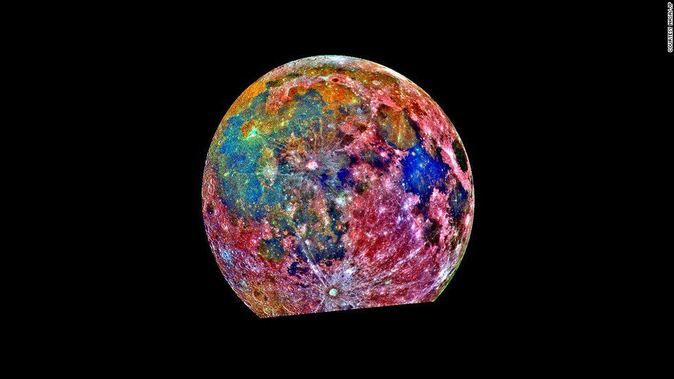"<strong><em>NASA, 1996</strong></em><br /><br />This NASA-produced false color image combined 15 images of the moon taken by the aptly named Galileo Orbiter, in 1992. The different colored filters indicate soil composition. Red areas generally correspond to the lunar highlands, and blue to orange shades indicate the ancient volcanic lava flow of a ""mare,"" or lunar sea. Bluer mare areas contain more titanium than the orange regions."