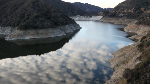 Rocky shores are exposed by the low waters of Morris Reservoir, on the San Gabriel River near Azusa, California, in January 2014.