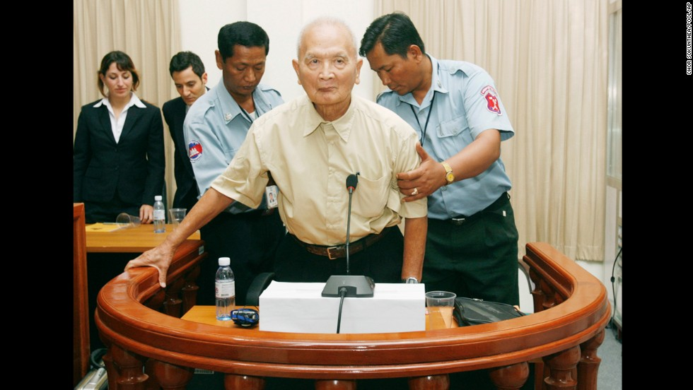 Nuon Chea, a former leader in the Khmer Rouge reign of terror and right hand man to Pol Pot, gets help to stand up in the dock before a hearing in 2008 at the U.N.-backed Cambodian war crimes court in Phnom Penh. A verdict is expected in August on Chea's indictment over atrocities.