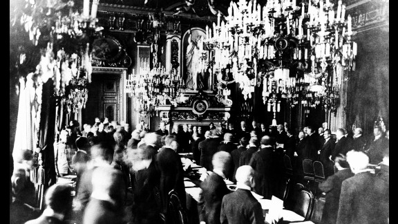 "At Versailles Palace, representatives of Germany and the Allies sign the treaty that ended World War I, June 28, 1919. Article 231, the notorious War Guilt clause, required ""Germany (to) accept the responsibility of Germany and her allies for causing all the loss and damage"" during the war."