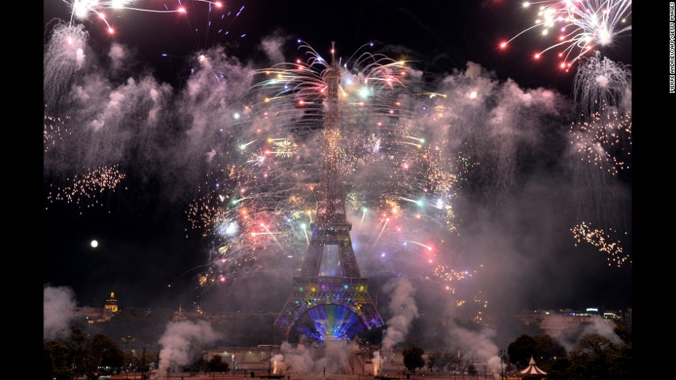Fireworks burst around the Eiffel Tower during the annual Bastille Day celebrations in Paris on Monday, July 14. The festivities commemorate the beginning of the French Revolution with the storming of the Bastille in 1789.