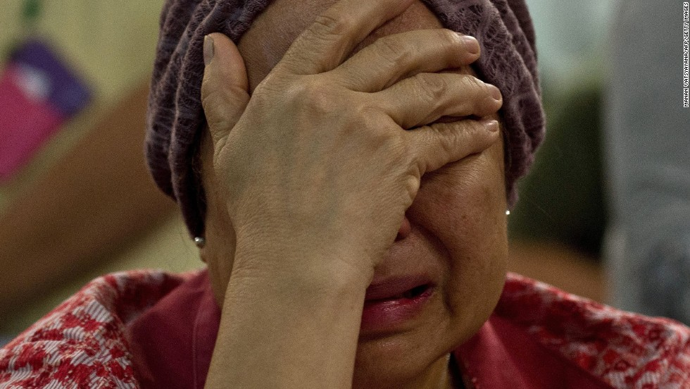 Akmar Binti Mohd Noor, whose sister was aboard Flight 17, cries outside the family holding area at Kuala Lumpur International Airport on July 18.