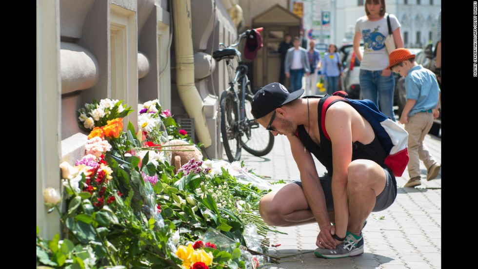 People place flowers in front of the Dutch Embassy in Moscow on July 18.